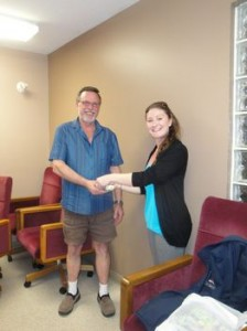 Lisa presenting Reid with money raised at Bokwa and Yoga fundraiser